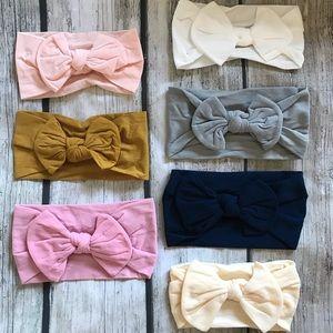 Other - Brand New Set of 7 Soft Nylon Bow Headbands 0-6 Y